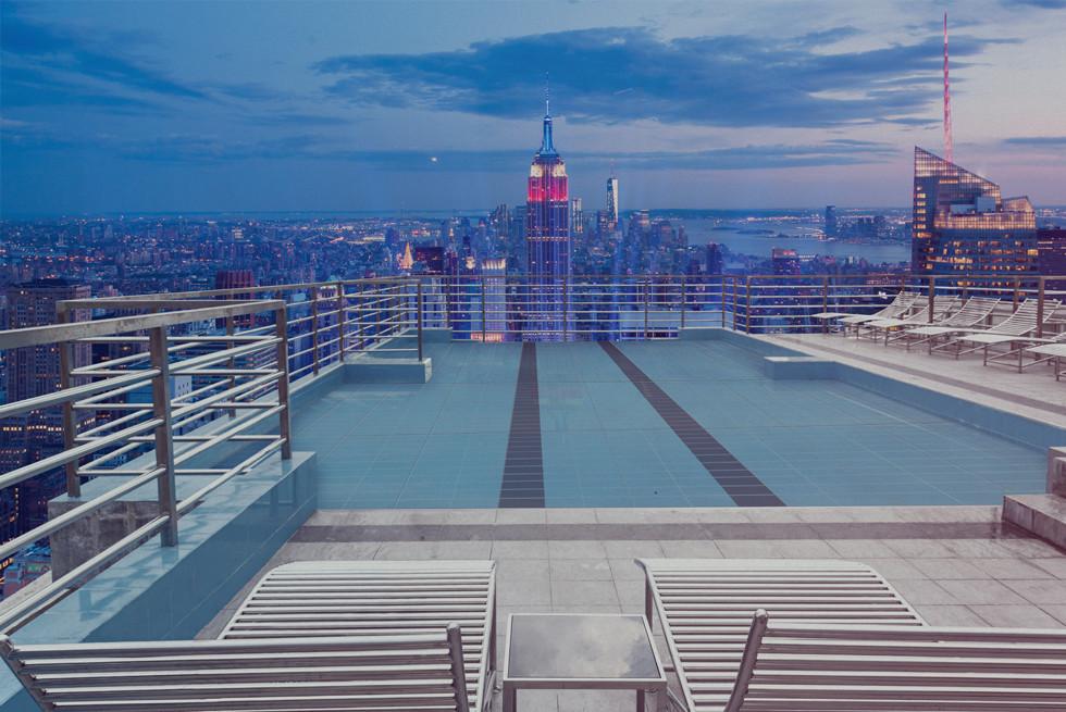 """רצפה מתרוממת לבריכה על גג בית מלון - אחר. רצפת הבריכה עולה כלפי מעלה ע""""י פטנט ייחודי"""